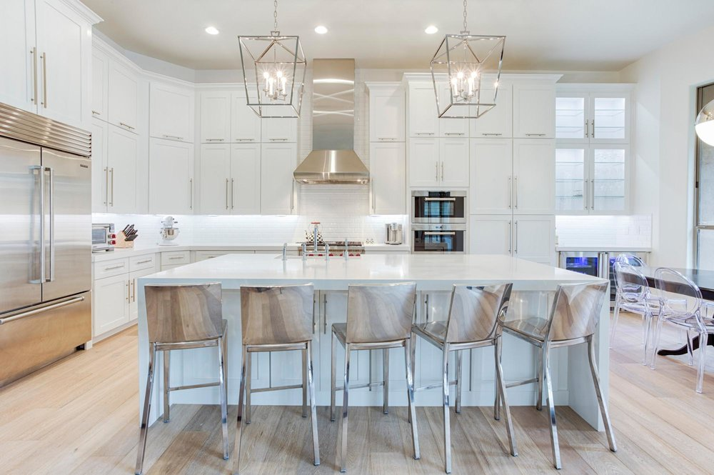 Kitchen with stainless steel appliances and bar stools