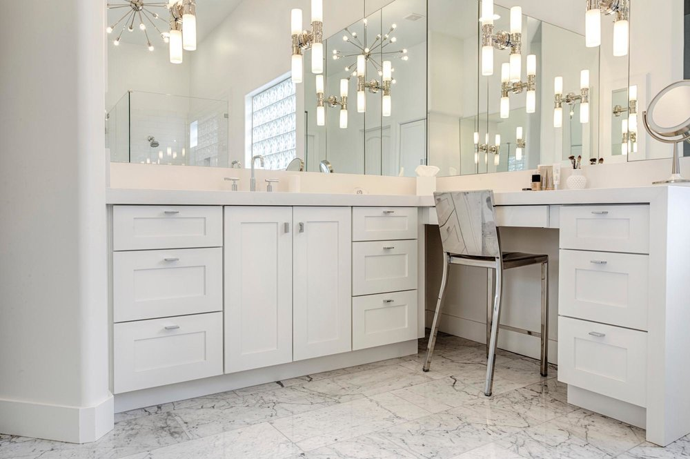 Bathroom with white countertops sink and stylish hanging lights