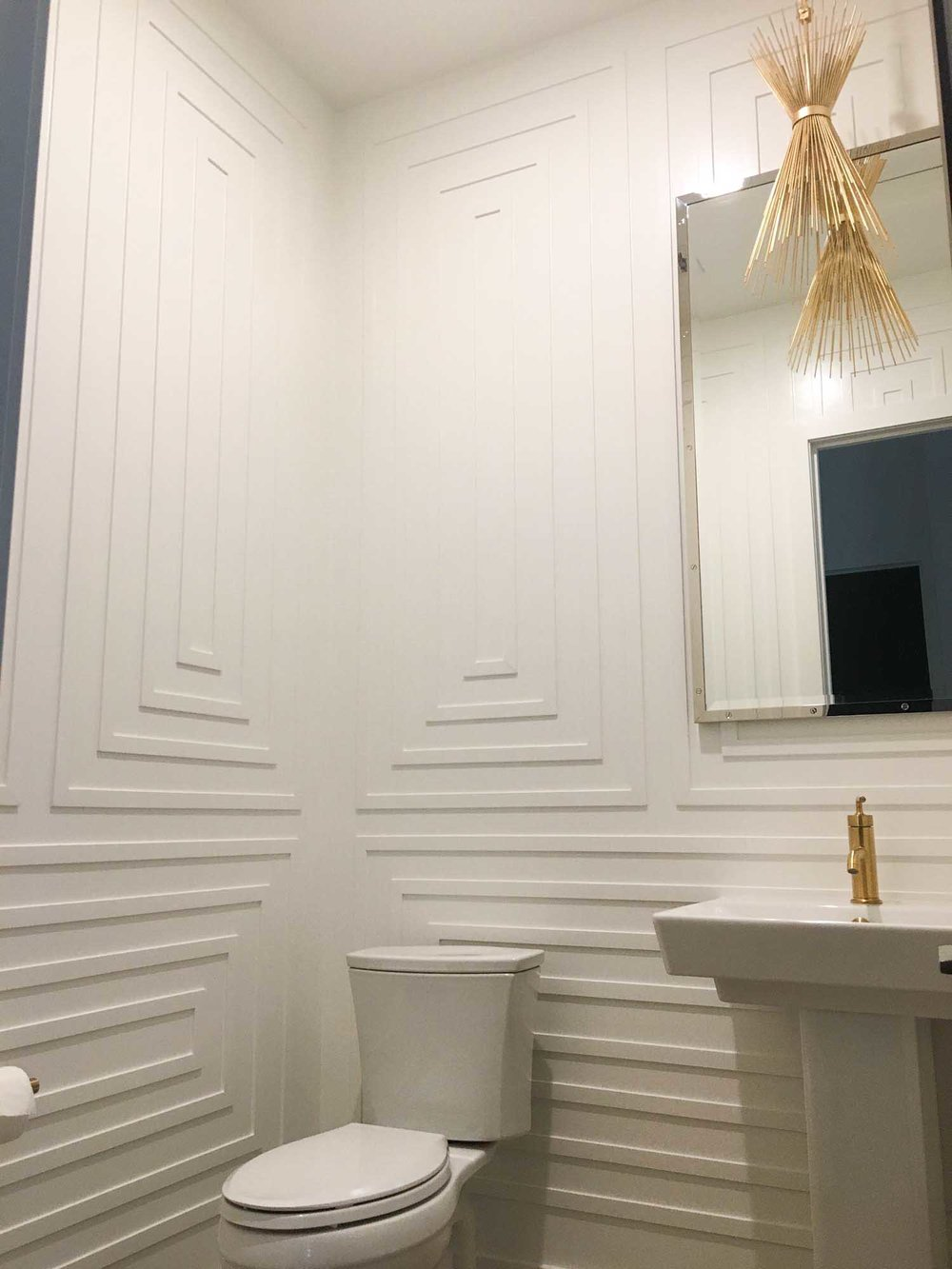 Toilet with white decorative wall and stylish lights