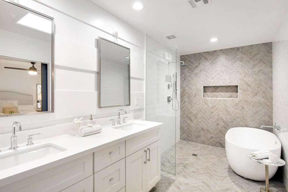Bathroom with white bathtub and glass shower room