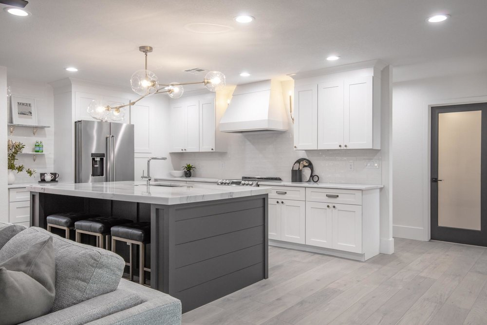 Kitchen with white cabinets and stylish lights
