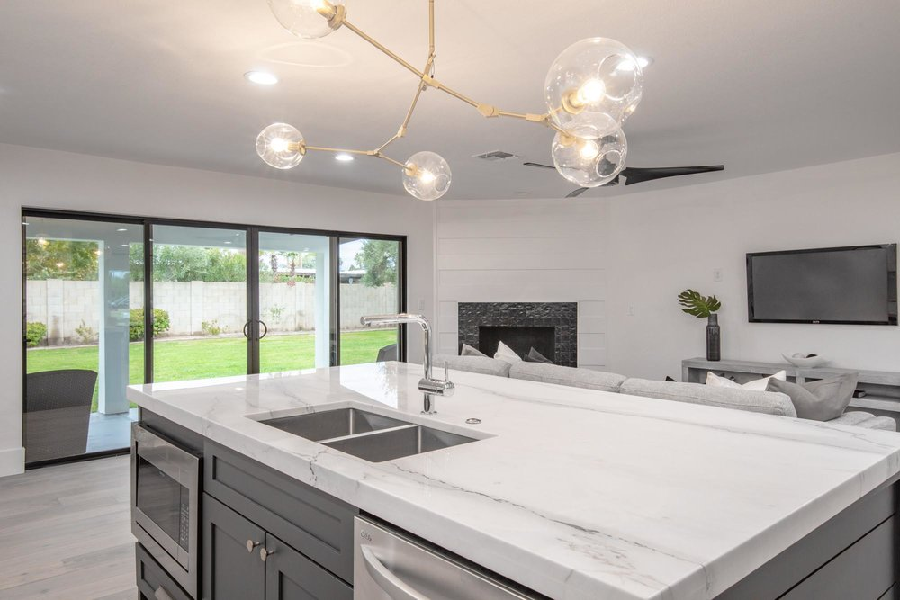 Kitchen with white cabinets and countertops island