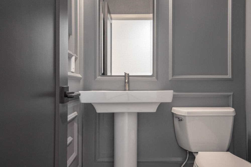 Toilet with white bowl sink and faucet