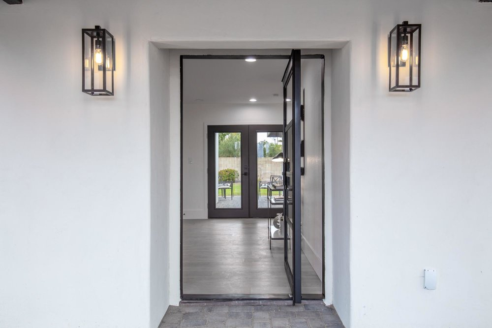 House entryway with wall mounted lamps