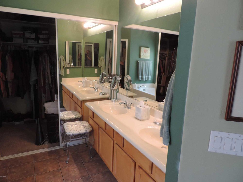 Dressing room  with sink and faucet and  large mirror