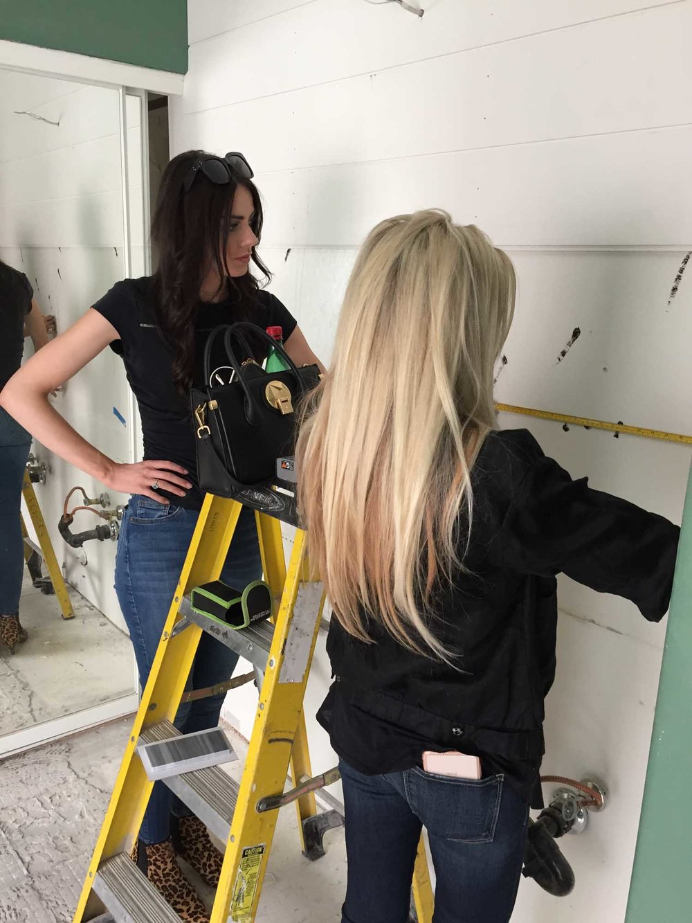 Two women working together in room renovation