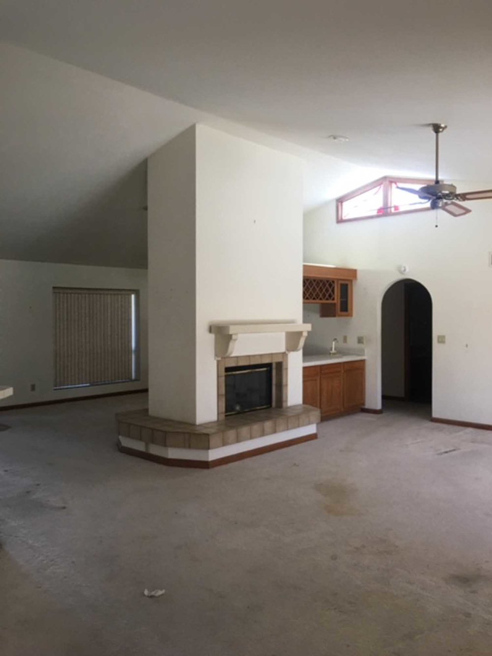 An old kitchen room with fireplace