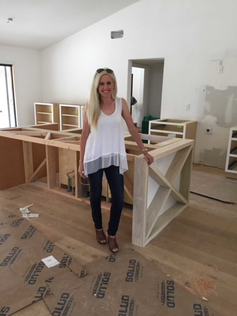 Woman standing in under renovation room