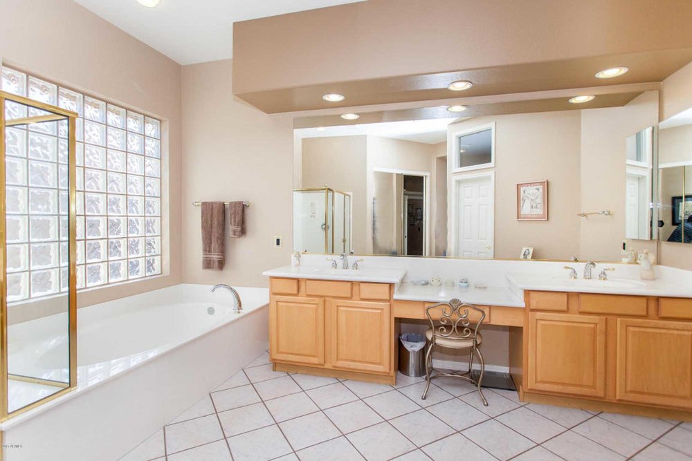 Old spacious bathroom with bathtub and wide mirror