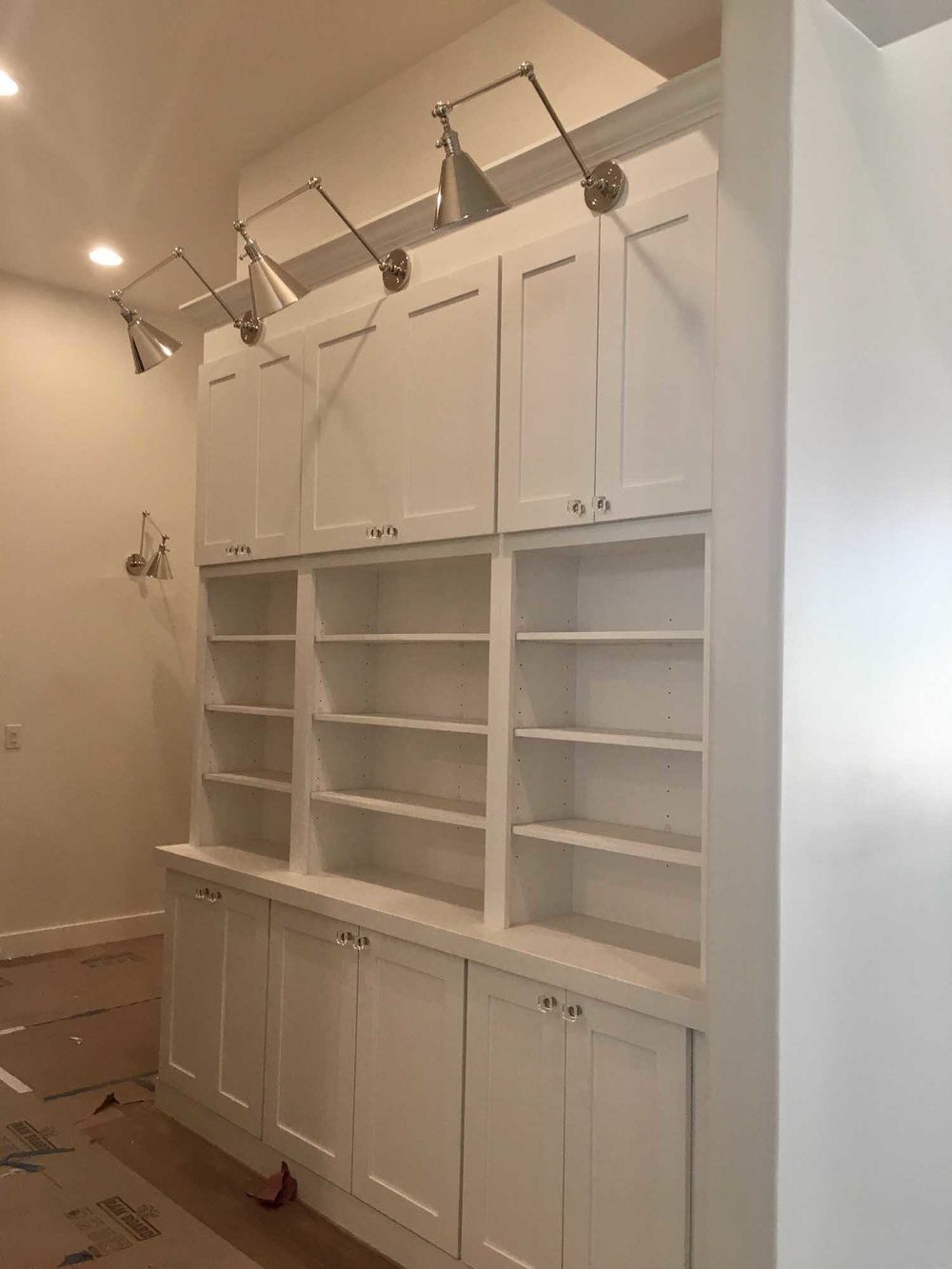 Room with white cabinet and cupboard with overhead lights