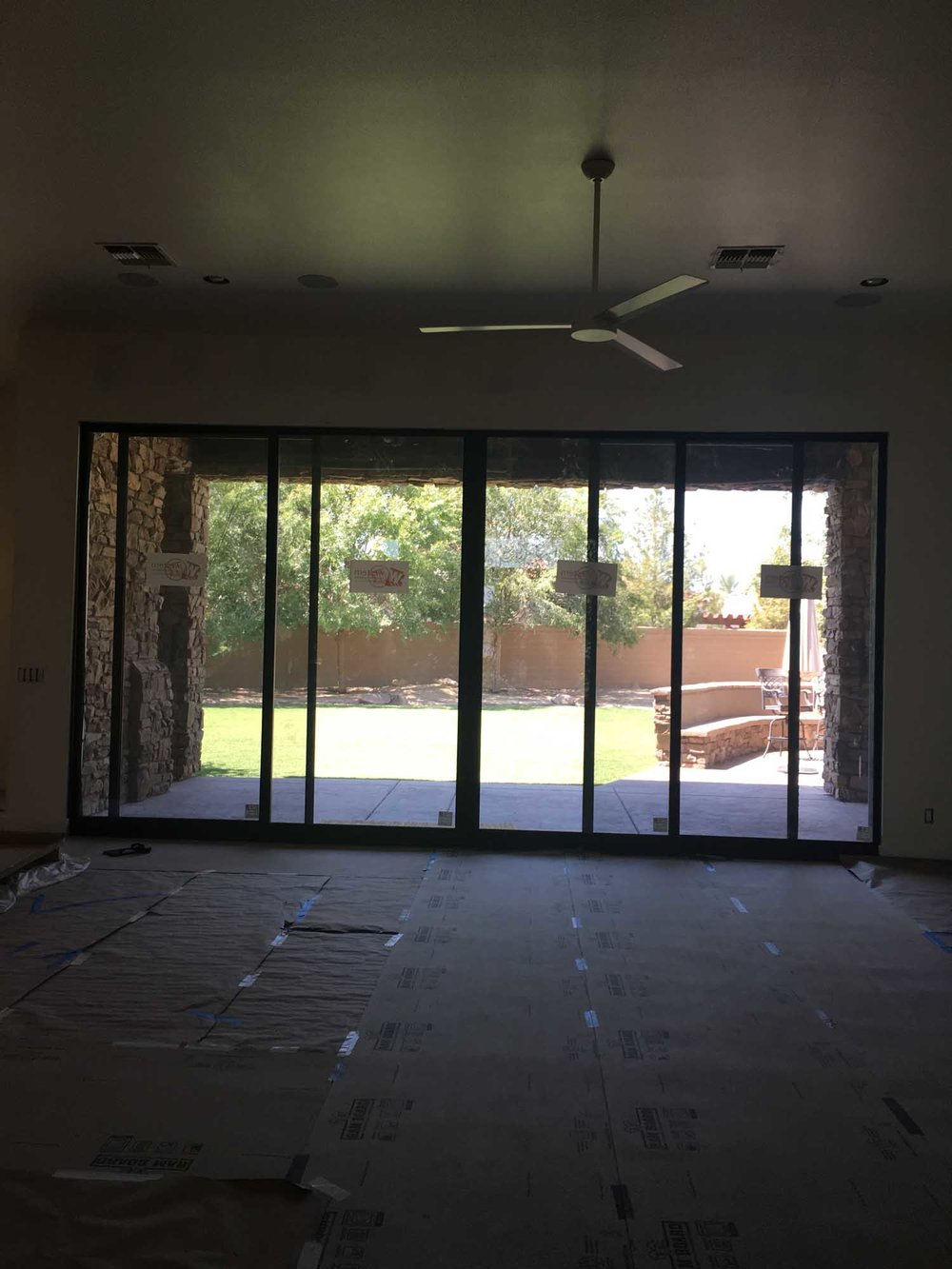 Ongoing renovation of room with wide sliding glass doors