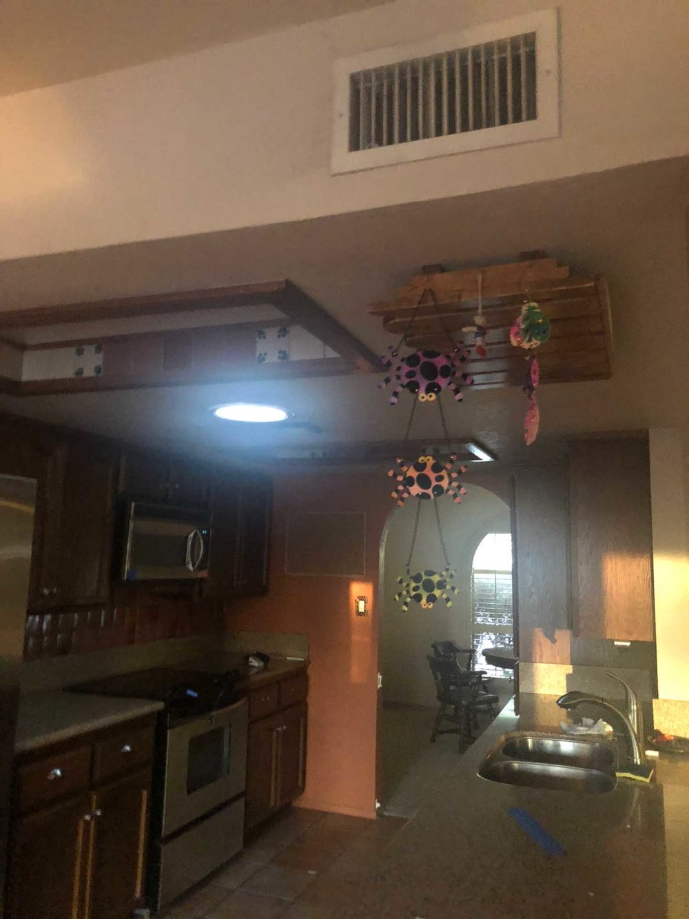 Kitchen with old ceiling mouldings and decorations