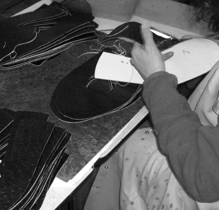 HAND STITCHING THE LEATHER.jpg