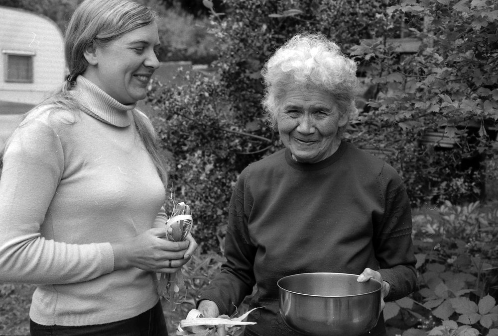 Nlaka'pamux elder Annie York, holding a bowl of soapberries, shows Nancy Turner how to make a soapberry whip from maple, early 1970s |  Nancy Turner / Hakai Magazine