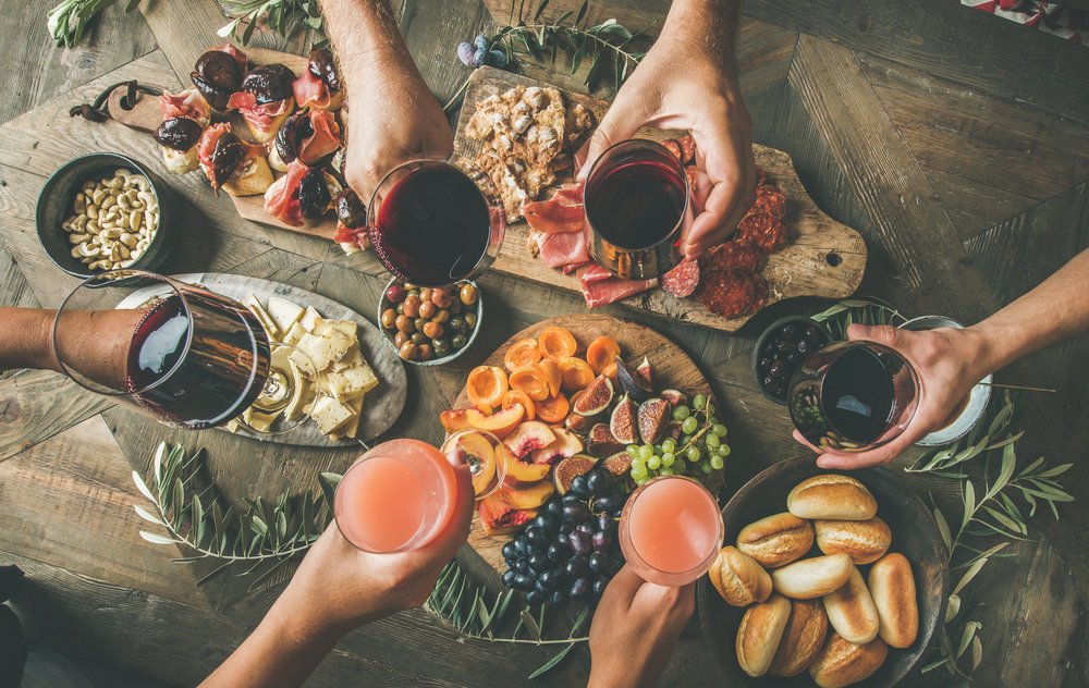 people-having-party-sitting-at-table-set-with-PF3YY7M.jpg