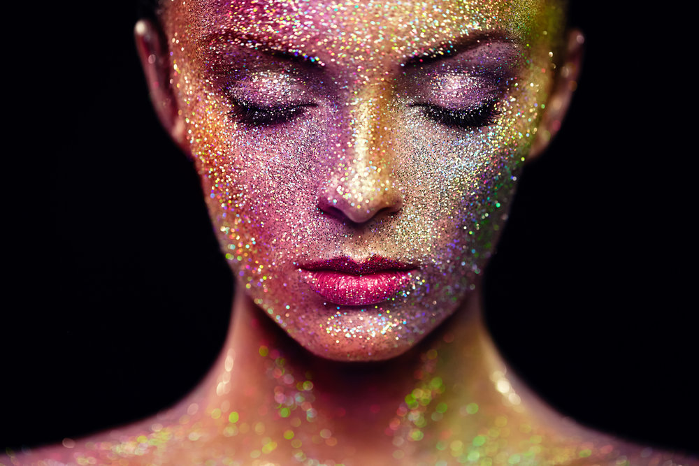 portrait-of-beautiful-woman-with-sparkles-on-her-P6ZHVNH.jpg