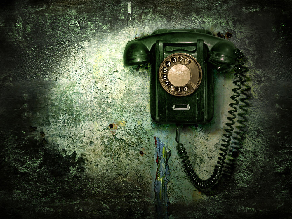 old-phone-on-the-destroyed-wall-PNWMYRE.jpg