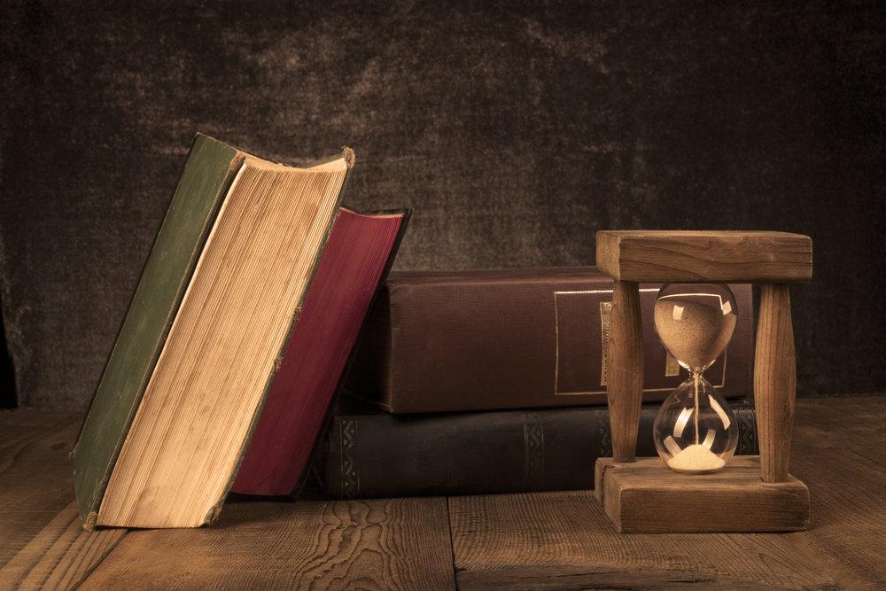 old-books-with-hourglass-RW8XA7S.jpg