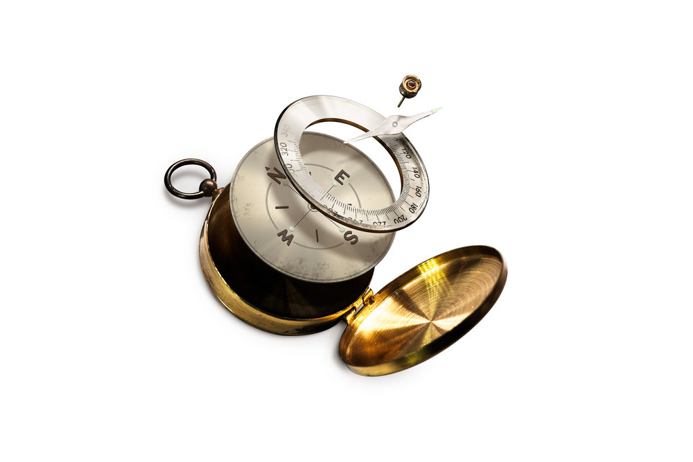 isolated-image-of-disintegrate-brass-compass-PQCZCVE.jpg
