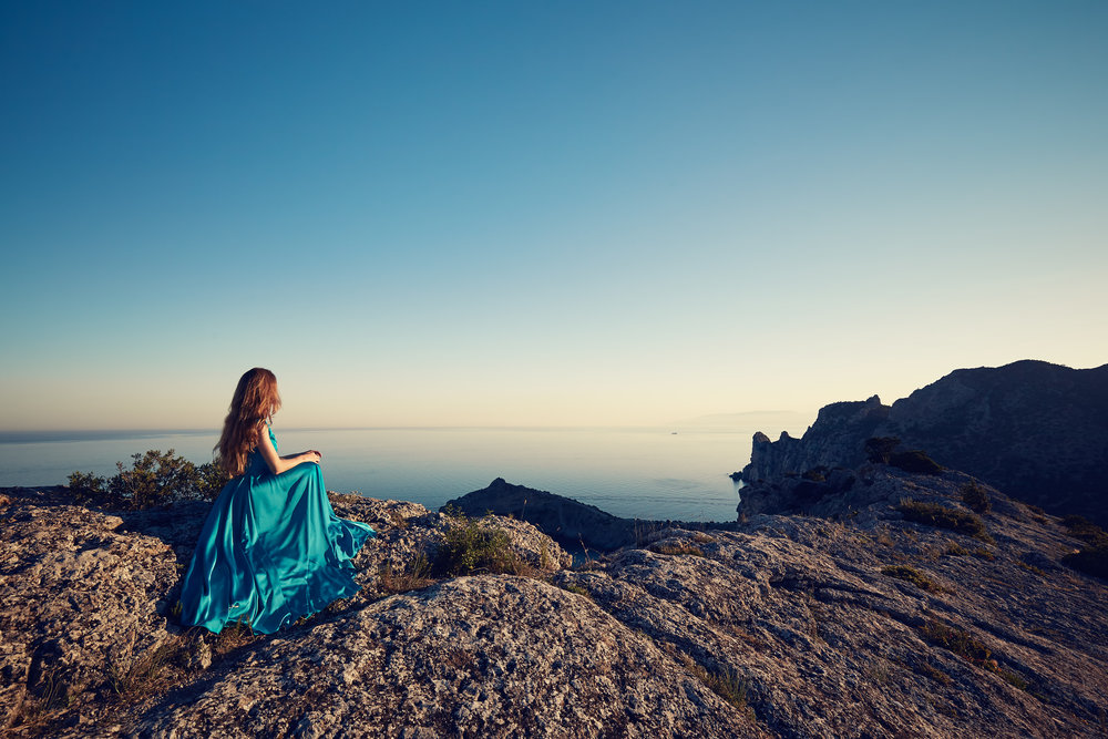 young-beautiful-woman-in-blue-dress-looking-to-PZBQRJ4.jpg