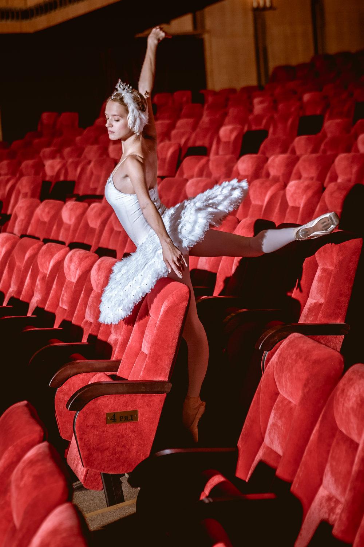 ballerina-sitting-in-the-empty-auditorium-theater-PQM48JU.JPG