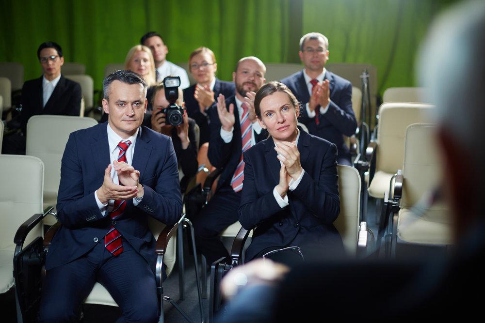 audience-applauding-to-speaker-PN9THWP.jpg