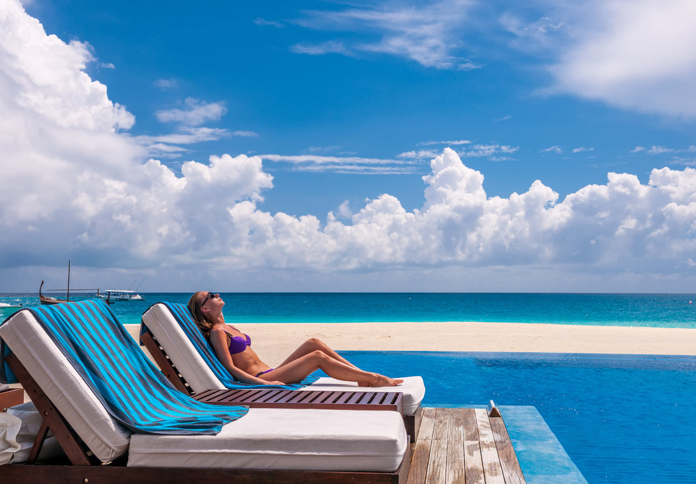 woman-relaxing-at-the-poolside-PN7FGWY.jpg