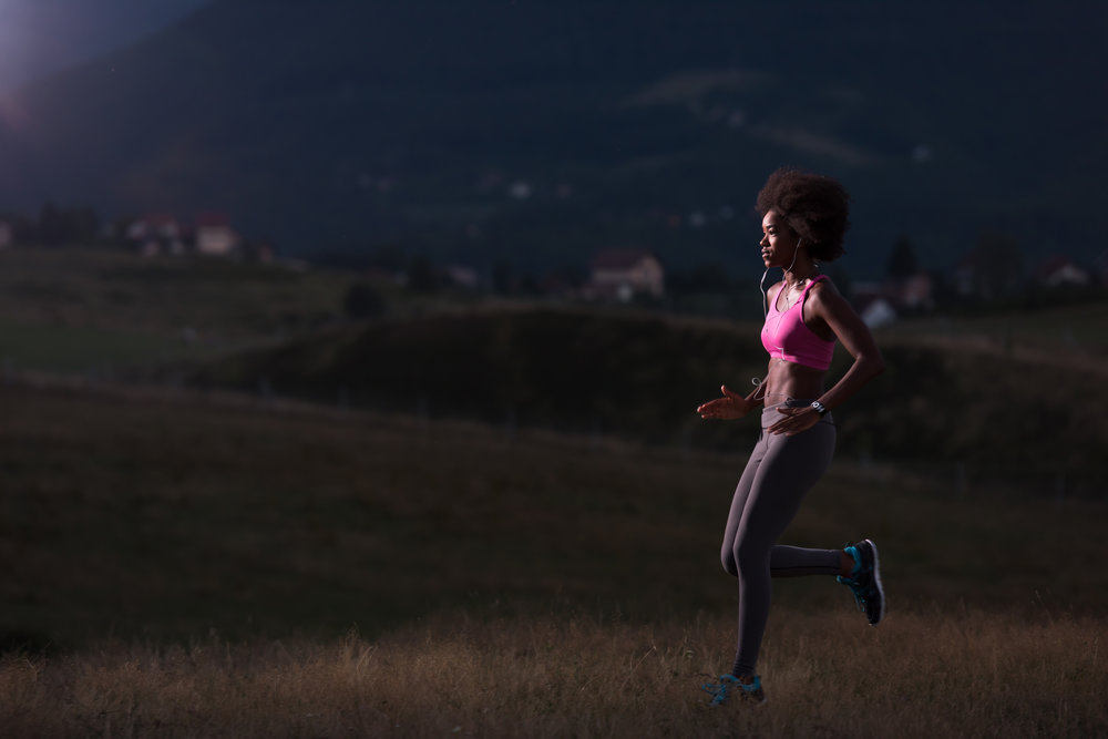 young-african-american-woman-jogging-in-nature-PD4BVH5 (1).jpg