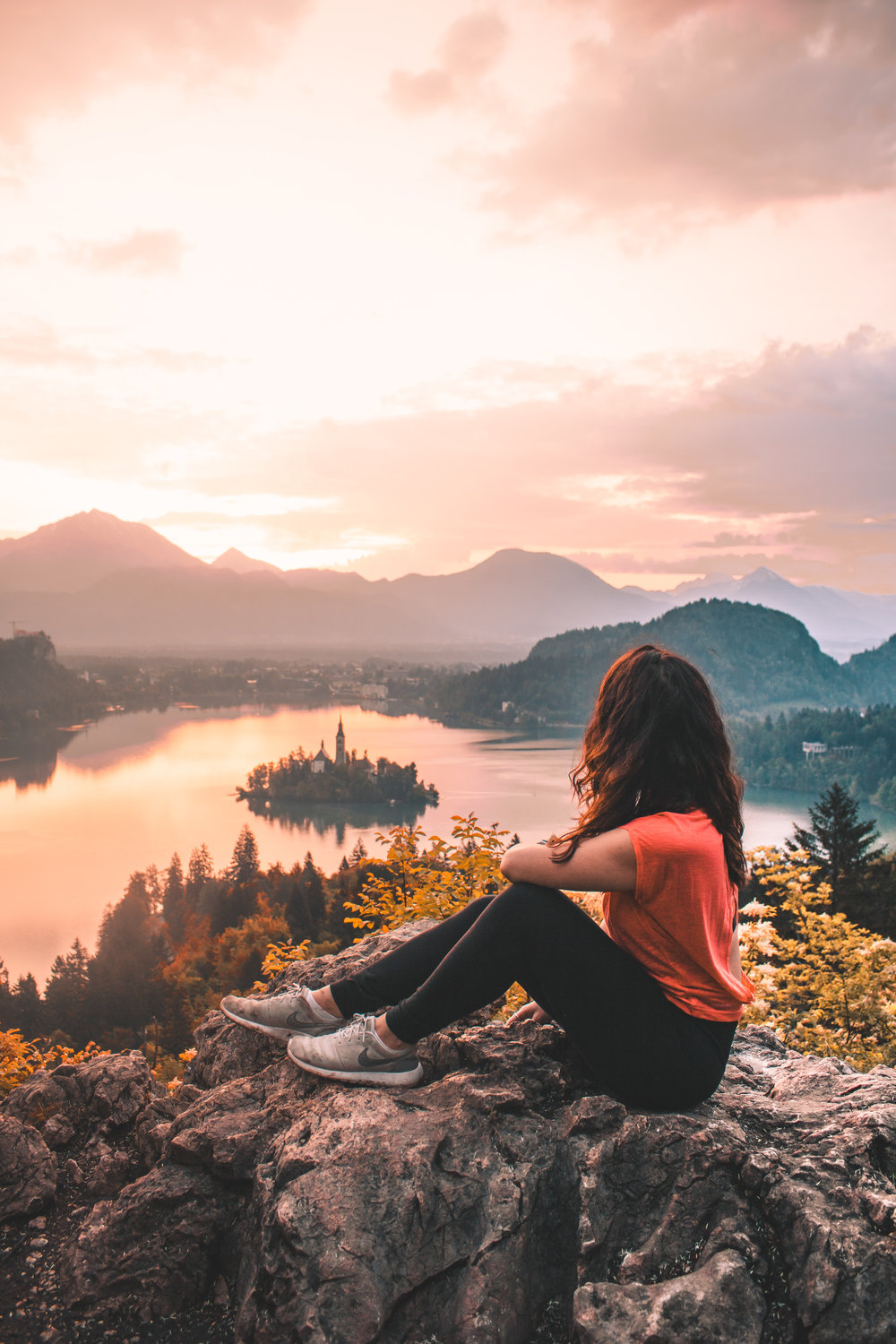 Girl watching Sunrise over Lake Bled
