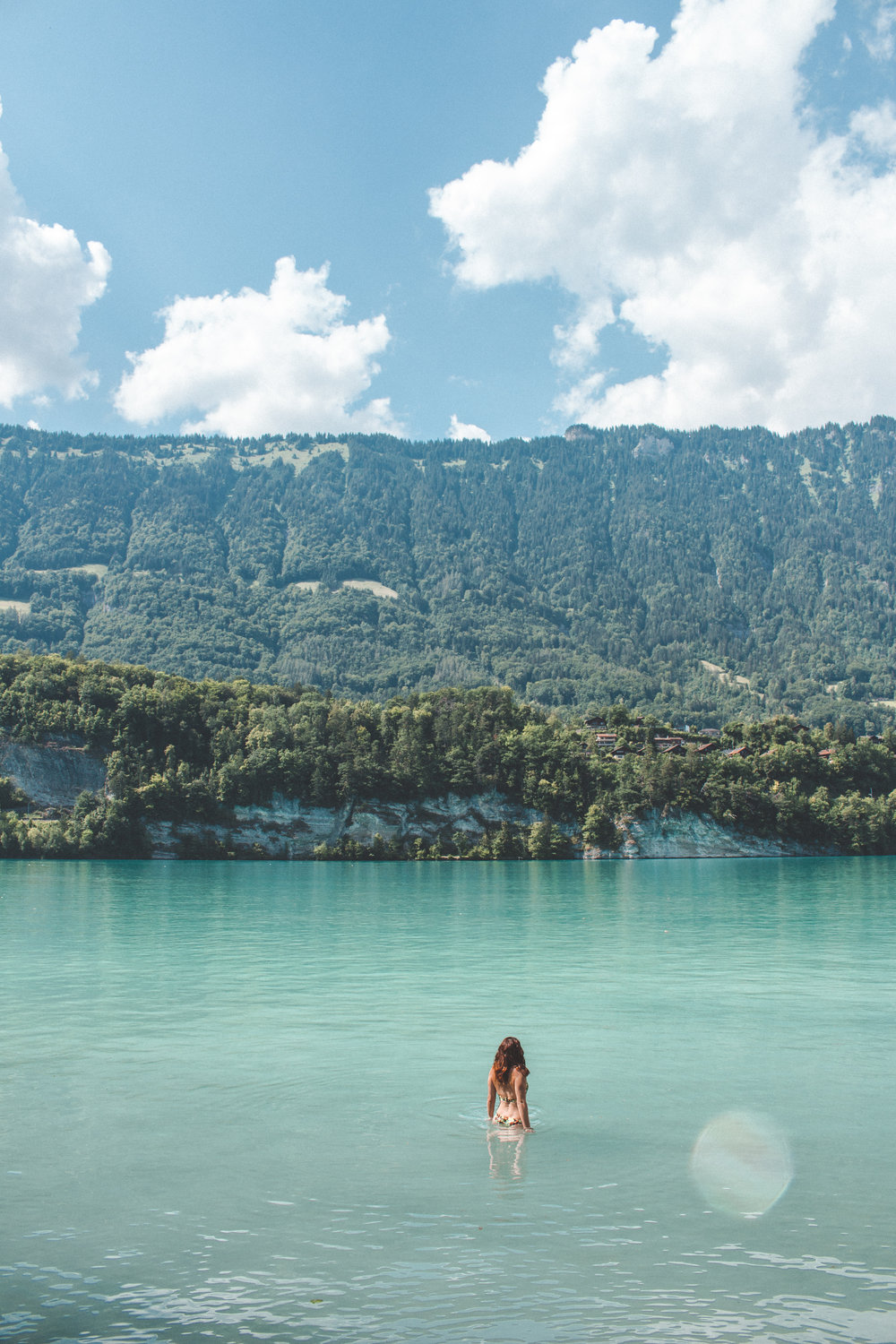 Girl swimming in mountain lake