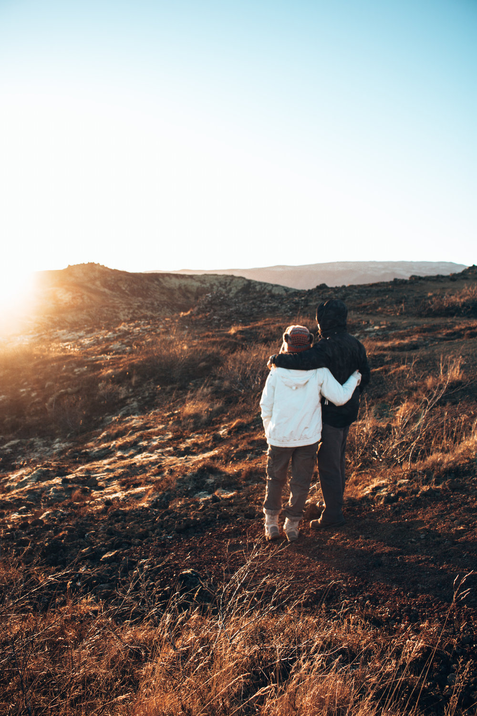 Couple watching Icelandic sunset