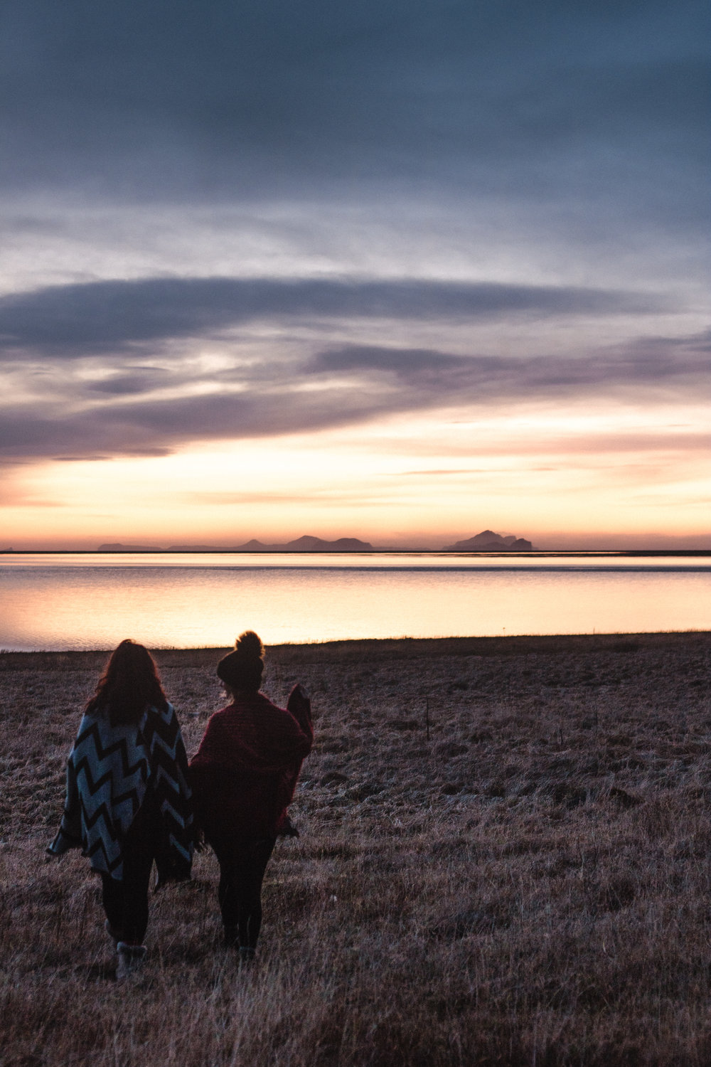 Icelandic Field and sunset with girl watching