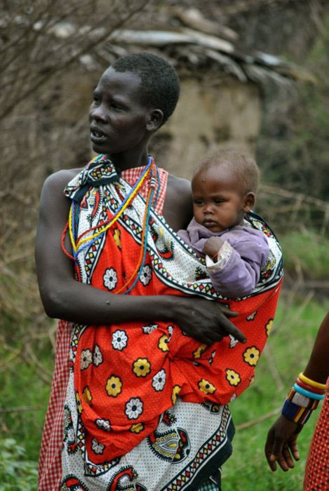 Massai Mother wearing her baby in a sling.