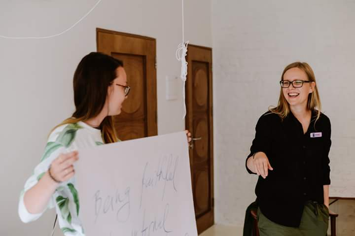 Agnese Aljēna and Masha Zurikova during a lecture (organisers of USK Riga)