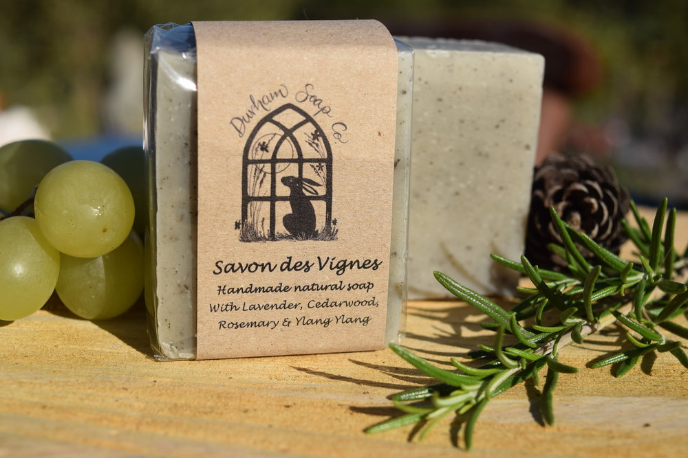 Savon Des Vignes - Natural soap, handmade with our blend of pure plant oils, enriched with moisturising shea butter, cocoa butter and castor oil for a rich and creamy lather. Our soap also contains natural French green clay for its detoxifying properties and is fragranced with a blend of lavender, cedar wood, rosemary, ylang ylang and patchouli essential oils to awaken the senses and evoke the scents of the hills and vineyards of Provence. Ingredients: Olive oil), coconut oil, sunflower oil, shea butter, cocoa butter, water), castor oil, green clay, Lavender oil, cedar wood oil, ylang ylang oil, rosemary oil, patchouli oil,Vitamin E, Benzyl benzoate*, Limonene*, occurs naturally in essential oils.