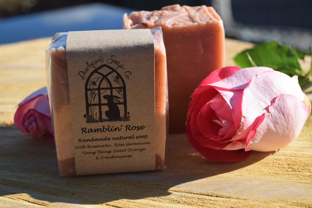 Ramblin Rose - Natural soap, handmade with our blend of pure plant oils, enriched with moisturising shea butter, cocoa butter and castor oil for a rich and creamy lather. Our soap is fragranced with a blend of rosewater, rose geranium, sweet orange, frankincense and ylang ylang essential oils and gently coloured with natural pink clay to evoke the sweet floral scent of a summer rose garden. Ingredients: Olive oil, coconut oil, sunflower oil, shea butter, cocoa butter, water, castor oil, rosewater, pink clay, rose geranium oil, ylang ylang oil, sweet orange oil, frankincense oil, Vitamin E, Benzyl benzoate*, Benzyl salicylate*, Citral*, Citronellol*, Farnesol*, Geraniol*, Limonene*, Linalool*, * = occurs naturally in essential oils.