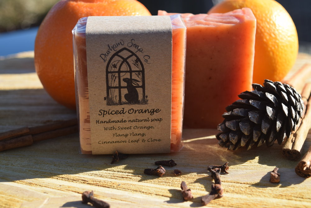Spiced Orange - Natural soap, handmade with our blend of pure plant oils, enriched with moisturising shea butter, cocoa butter and castor oil for a rich and creamy lather. Our soap is fragranced with a blend of sweet orange, cinnamon, clove and ylang ylang essential oils to evoke the warming scents of the kitchen and fireside over the festive season. Ingredients: Olive oil, coconut oil, sunflower oil, shea butter, cocoa butter, water, castor oil, sweet orange oil), paprika, ylang ylang oil, cinnamon oil, clove bud oil), Vitamin E, Benzyl benzoate*, Benzyl salicylate*, Eugenol*, Farnesol*, Limonene*, Linalool*, * = occurs naturally in essential oils.