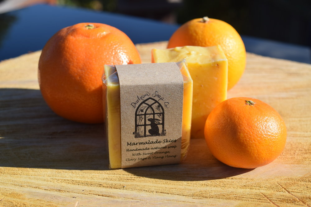 Marmalade Skies - Natural soap, handmade with our blend of pure plant oils, enriched with moisturising shea butter, cocoa butter and castor oil for a rich and creamy lather. Our soap is infused with golden calendula petals and fragranced with a blend of sweet orange, clary sage and ylang ylang essential oils to awaken the senses with a sweet citrus and floral scent and a hint of psychedelia. Ingredients: Sodium Olive oil, coconut oil, sunflower oil, shea butter, cocoa butter, water, castor oil, sweet orange oil, clary sage oil, ylang ylang oil), calendula petals, Vitamin E, Annatto, Benzyl benzoate*, Benzyl salicylate*, Eugenol*, Farnesol*, Geraniol*, Limonene*, Linalool*, * = occurs naturally in essential oils.