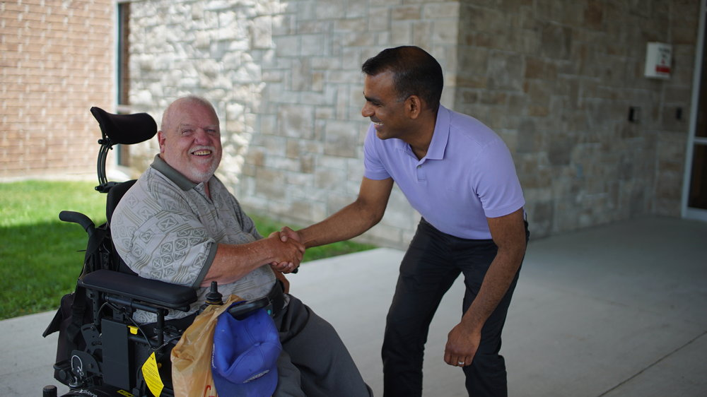 Handshake with a man on wheelchair