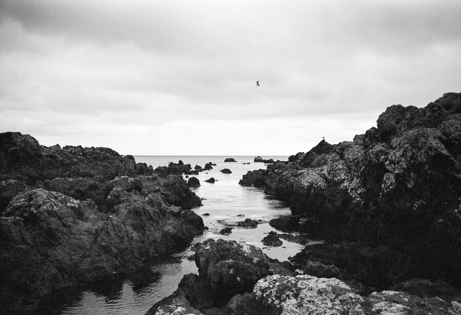 Ilford HP5 Plus - Around the Bays - View out to Sea through the Rocks.jpg