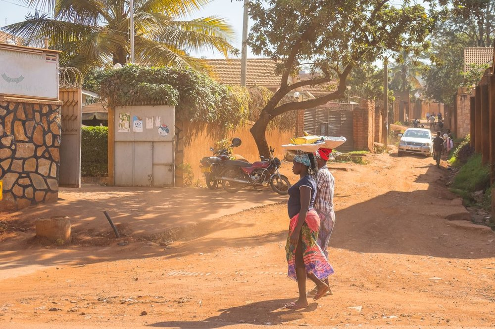 Women carrying baskets in Kampala