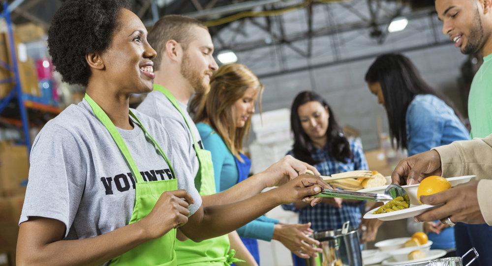 volunteers-serving-healthy-hot-meal-at-soup-kitchen-2.jpg