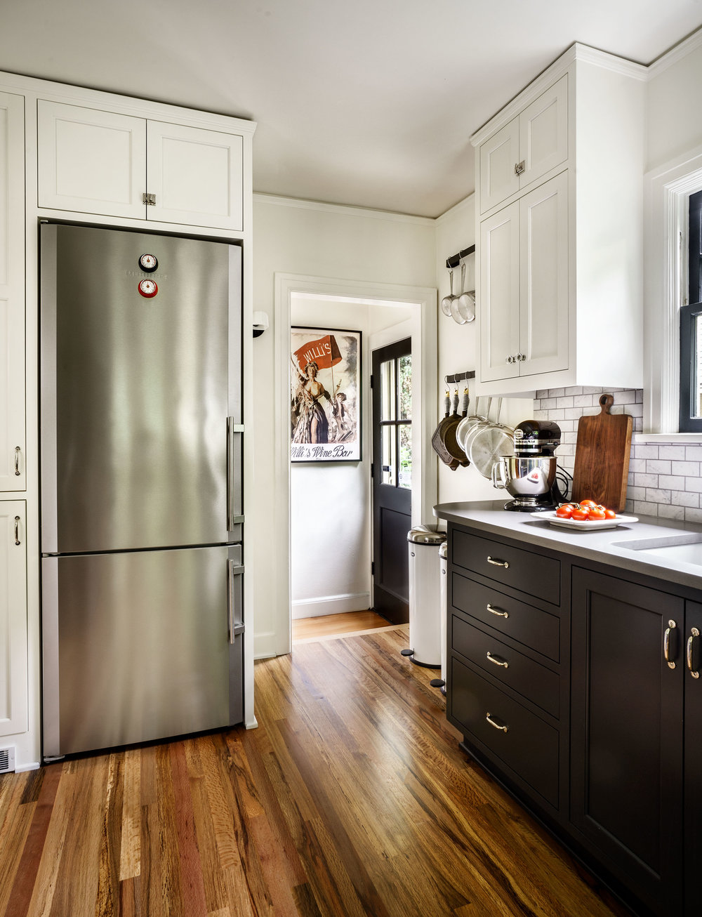 Freestanding fridge integrates into the cabinetry.