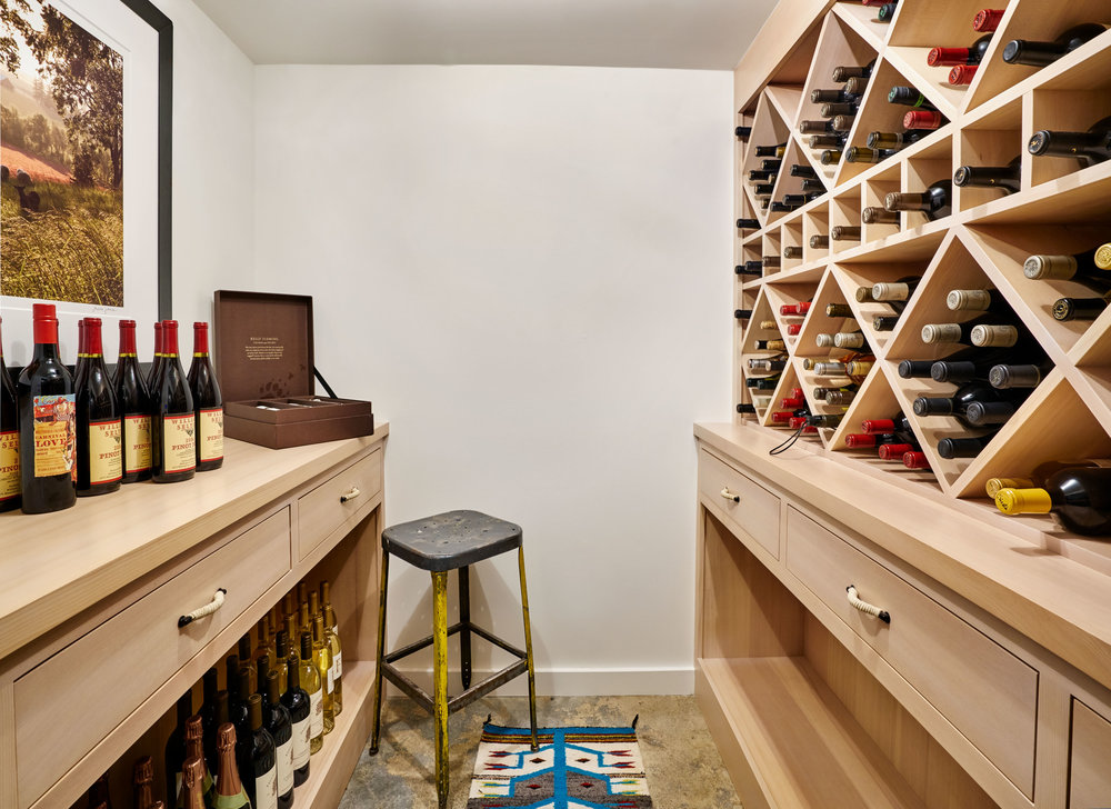 Wine cellar custom spruce built-ins.