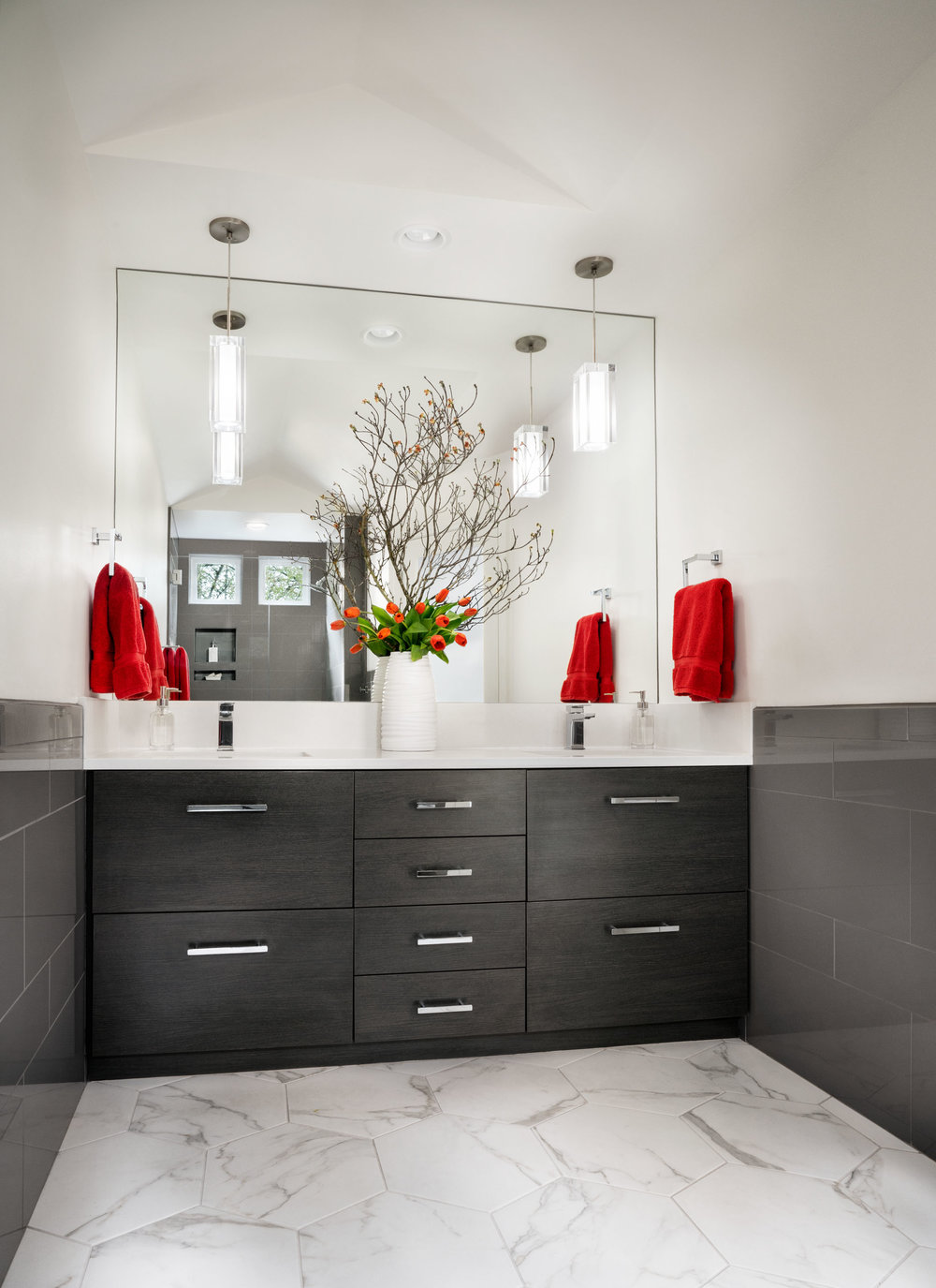 The bath's new contemporary lighting and cabinetry.