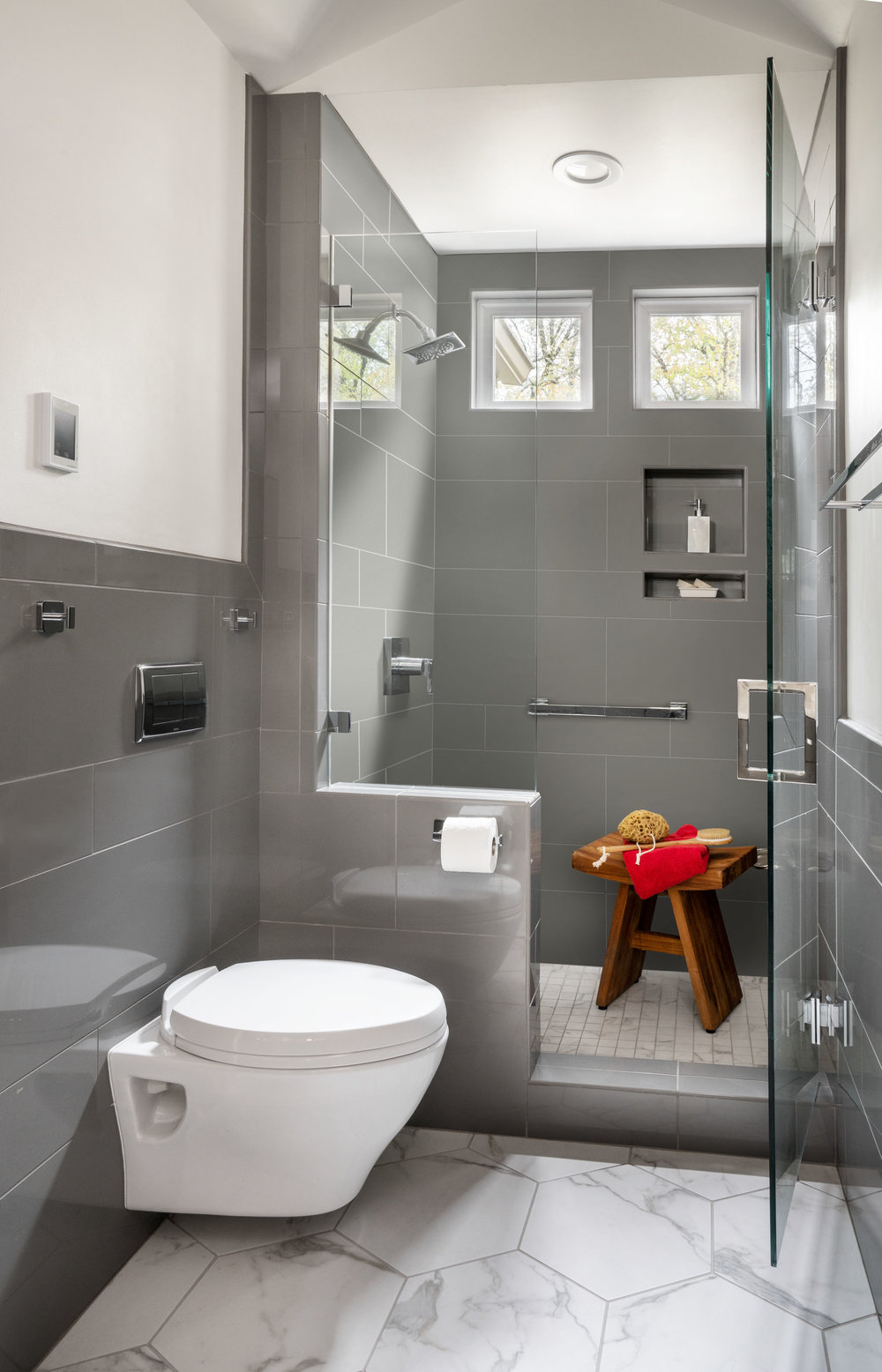 The wall mounted toilet creates extra space to access the shower.