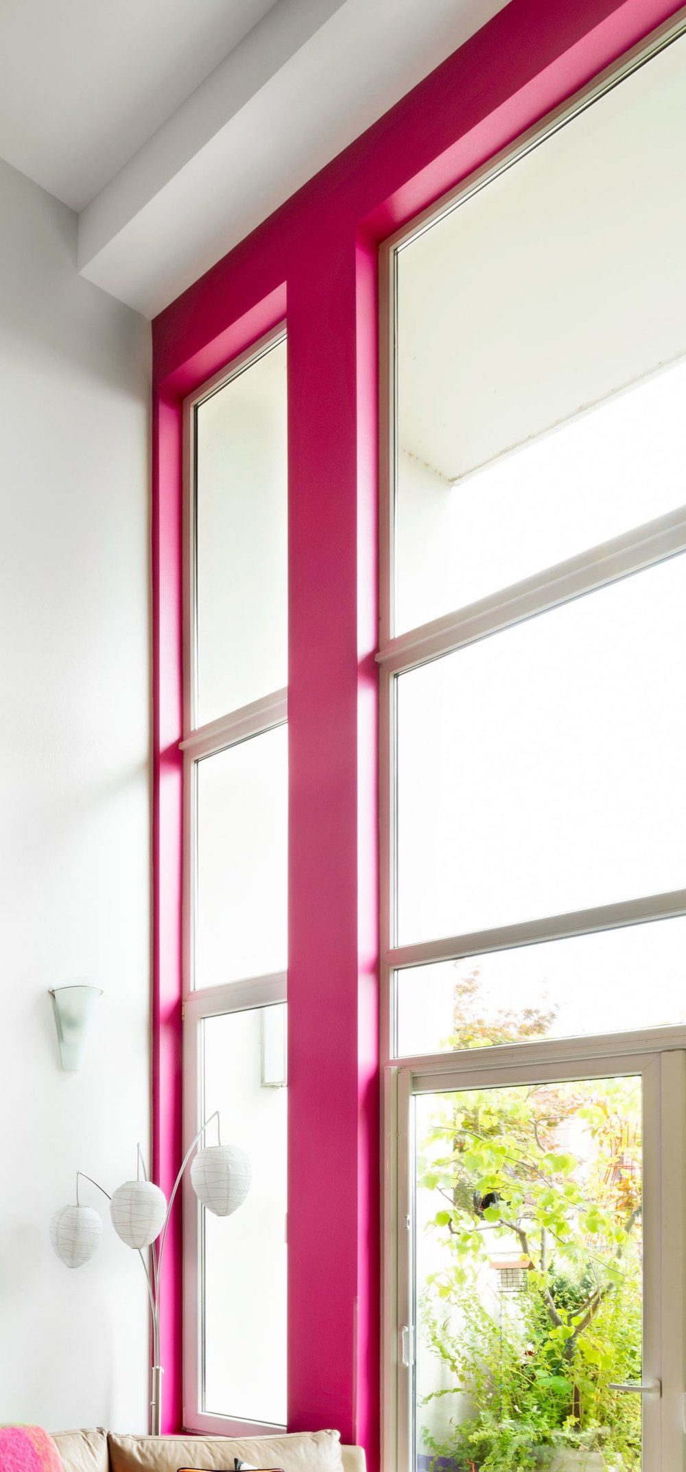 Floor to ceiling feature wall showcases the client's love of color.