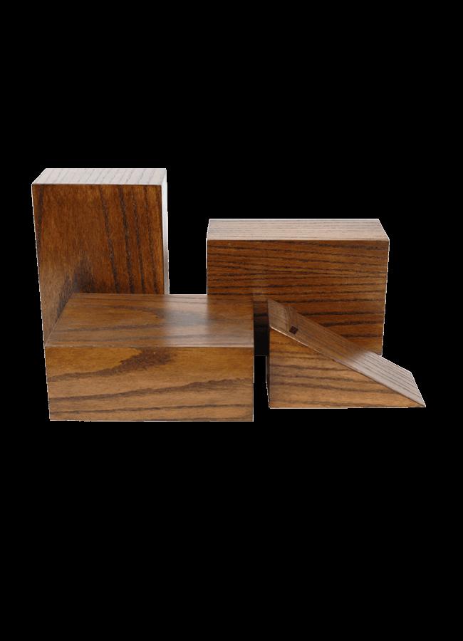"GE OMETRIC RISER COLLECTION   Item#   A. S0722005  Rectangular Riser 4"" x 7"" x 10""   B. S0722002  Triangular Riser 4"" x 4 ½"" x 9""  Shown in oak and Dark walnut finish"