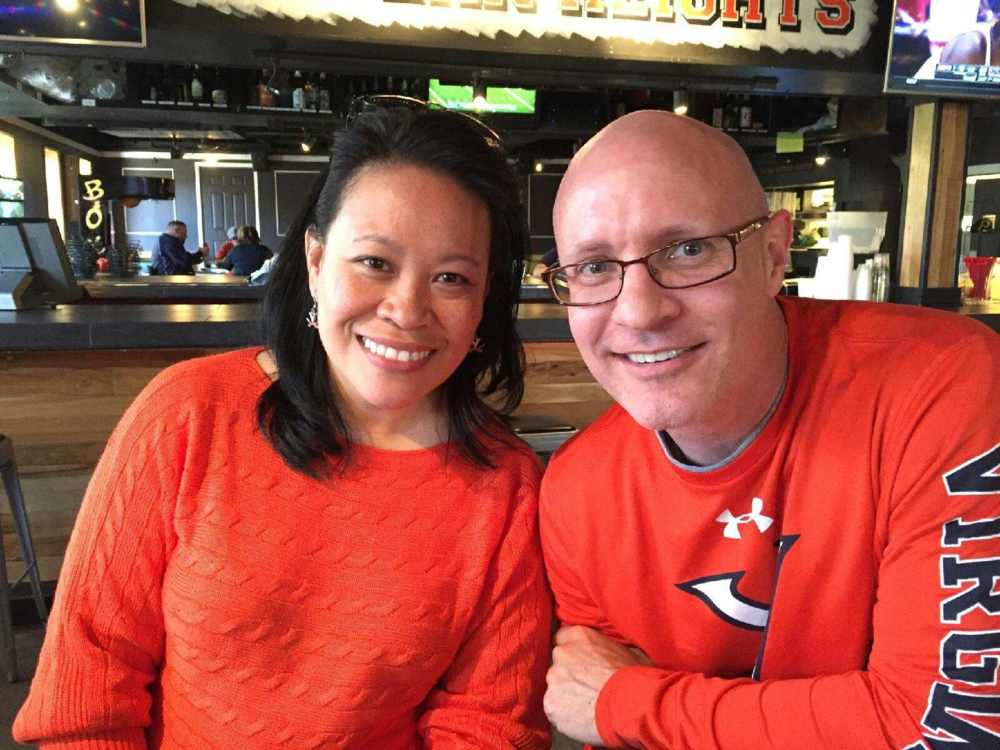 Rob and Susan Callahan sporting their UVA orange (1).png