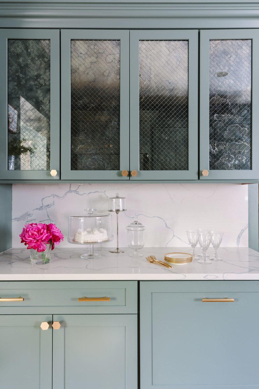 "Chicago interior designer Ann Sacks Versailles Mesh Cabinet Mirror with Caesar Stone ""Calcutta"" Quartz Backsplash and Countertops and CB2 Hardware"